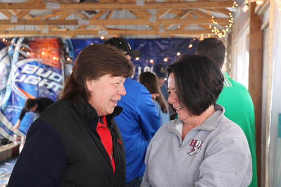 Photos/Kyla Hurt Paula Lane and Sandy Daniels (left to right) talk near the P.A.W.S. table that was set up for merchandise sold to raise additional monies for the group.