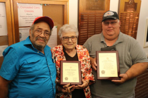 Morgan County VFW Post 1379 Commander Tom Wilson, Auxiliary President Connie Wilson and Senior Vice Commander Larry Cottrill (left to right) are pictured after the presentation of plaques to Connie Wilson.