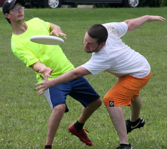 Michael Terhaar, left, of Springfield, sends a forehand throw downfield past defender Tanner Fillman, of Peoria, at the Jax Hat ultimate tournament Saturday, July 16, in Jacksonville.
