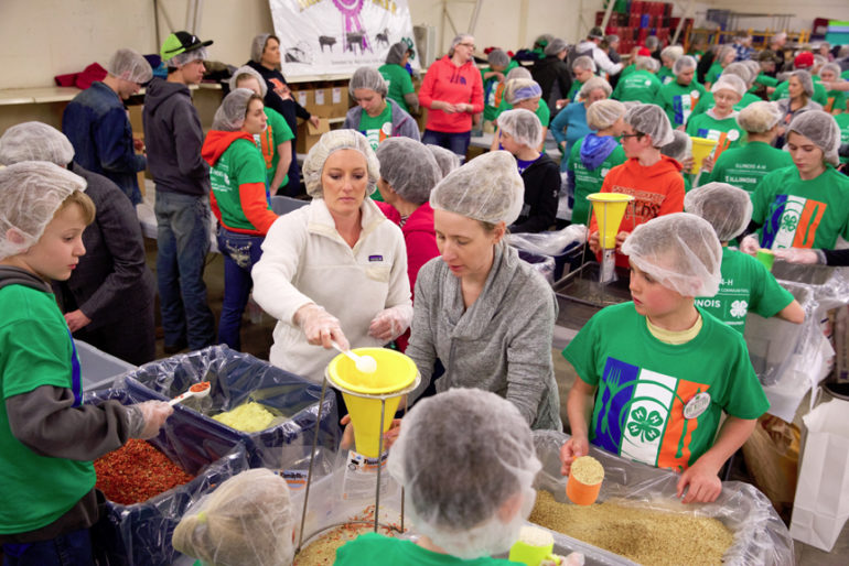 More than 75 volunteers from Cass, Morgan, Scott, Greene and Calhoun counties were on hand to put together meals at the 4-H Building at the Morgan County Fairgrounds.  The one millionth meal for families in need was packaged by 4-H volunteers Wednesday evening at the Morgan County Fairgrounds in Jacksonville. The state-wide program started in 2013, with 4-H members and others packaging the meals. Volunteers from Cass, Morgan, Scott, Greene and Calhoun were on hand to put together meals Wednesday. The 31st box of the night pushed the program past the one million mark.  Wednesday 4 April 2018 Photos by Steve of Warmowski Photography for The Source http://www.warmowskiphoto.com 217.473.5581 - 180404