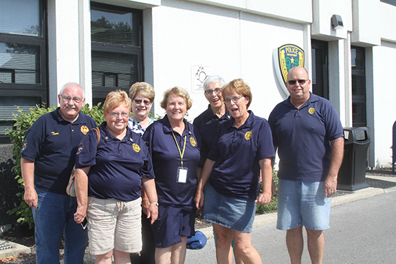 Pictured are (back row, left to right) Tom Cisne, Kathy Maul, Prudy Ballard and Everett Beddingfield. Pictured (front row, left to right) are Judy Cisne, Adah Mitchell and Cindy Beddingfield.  Members of alumni stand outside the city building.