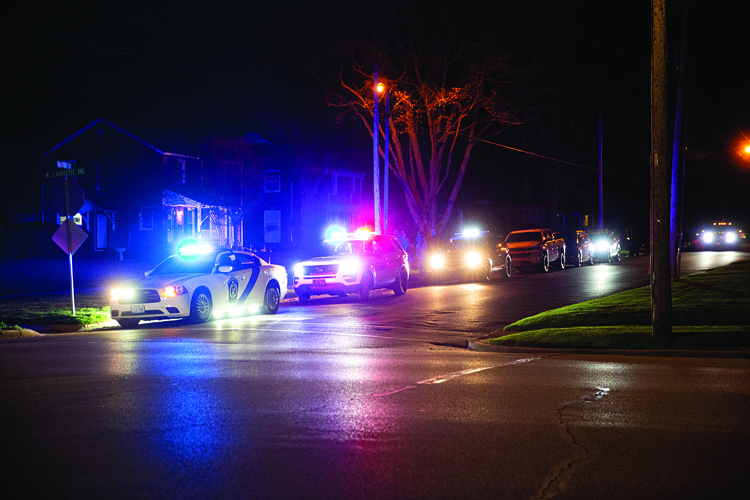 The Source/Tiffany Warmowski First responder vehicles line the street in front of Capt. Bloomfield's house Sunday night.