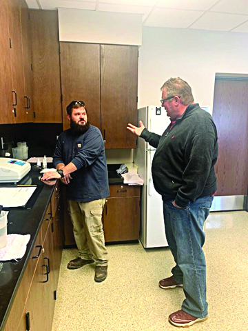 Photo/Beth Hopkins  Mayor Andy Ezard and Vance Kesinger discuss the different water samples that are taken. The City of Jacksonville Water Department employees are essential personnel.