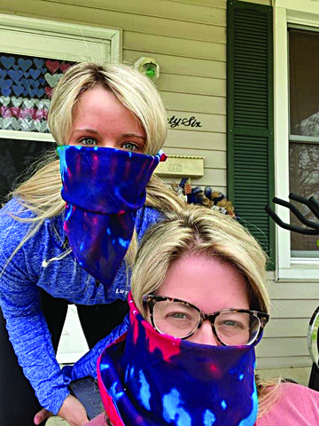 Photo/Submitted to The Source Heather and Karsyn Wardlow practice their masking skills.