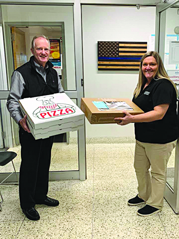 Photo/Submitted to The Source Country Financial Agent Rick Pettit showed his appreciation of essential personnel by delivering pizza to local police and fire departments as well as the West Central Dispatch Center. Pictured here with Dana Blakeman of the Jacksonville Police Department.