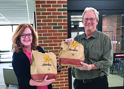 Dennis Hayes, long-time manager of the Jacksonville Hardee's, poses with Passavant Area Hospital Foundation Executive Director Pam Martin. Hardee's donated 30 breakfast sandwiches to the healthcare workers in Passavant's Outpatient Clinic, Advanced Wound Healing Center and Pain Management Clinic. Due to visitor restrictions at this time, all donations of food and supplies to Passavant must be prearranged by contacting Martin at Martin.Pam@mhsil.com