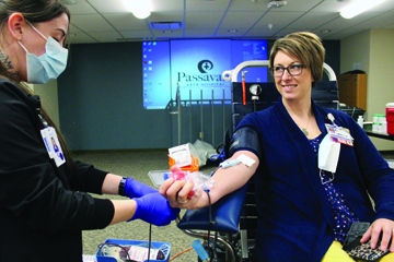Cara Crain, nurse manager at Passavant Area Hospital, donates blood during a recent employee blood drive at Passavant. Twenty-four units of blood were collected. Those 24 units will help 72 critically-ill patients. Especially impressive were the 15 first-time donors (employees at Passavant) who donated blood that day.