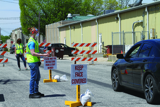 Trey Hopkins from the Morgan County Health Department checks patients in to the Morgan County COVID-19 testing site, located on Morgan Street, in Jacksonville on Friday, May 1.