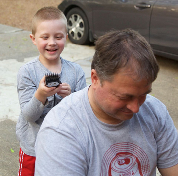 by Tiffany Warmowski   Alderman Steve Warmowski is receiving a haircut from his son Nicholas.