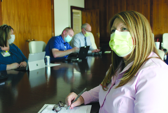 By B C    Sue Schleyhahn, Infection Prevention manager at Passavant Area Hospital, participates in one of the daily meetings of hospital leaders to update and implement Passavant's COVID-19 preparation and management plans.