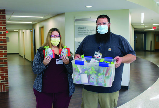 Kerri Barton (left), Environmental Services manager at Passavant Area Hospital, and Dan Capps, Environmental Services, pose with a donation from Toni Surratt and the Easley family. Surratt and the Easleys donated gift bags to each Environmental Services employee and made a monetary donation to Passavant's employee assistance fund, which provides emergency funds for hospital employees. Please note: Passavant is no longer accepting donations of food or meals from the community. This restriction was put in place to ensure the safety of hospital colleagues and patients by reducing the potential for large gatherings in breakrooms where social distancing is difficult.