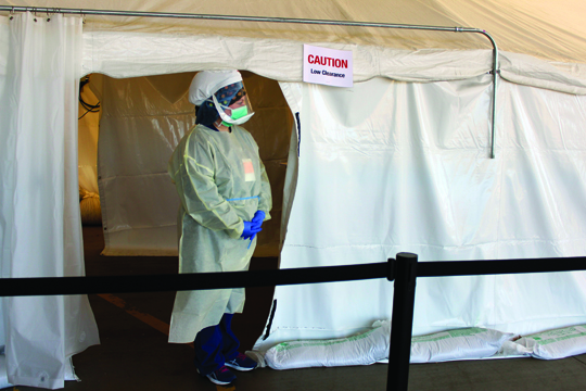 Kayla Sharrow, RN, redeployed from the surgery department, stands outside a Forward Triage Tent outside the Emergency Department at Passavant Area Hospital.
