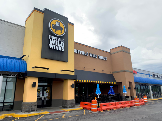 Buffalo Wild Wings is just one of several restaurants that has created a blocked off eating area to comply with social distancing rules.
