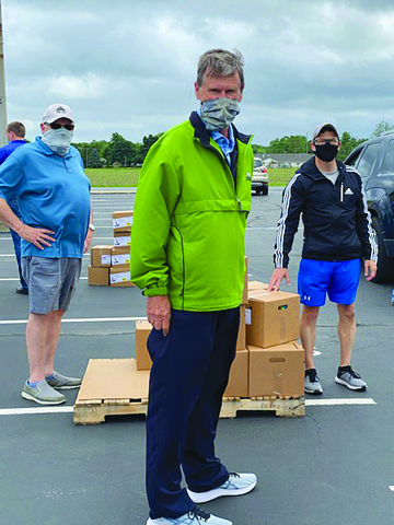 Keith Bradbury, Steve Turner and Mike Oldenettal were a few of the volunteer Kiwanis members on hand to assist in getting food distributed to many people while maintaining social distancing during a food giveaway.