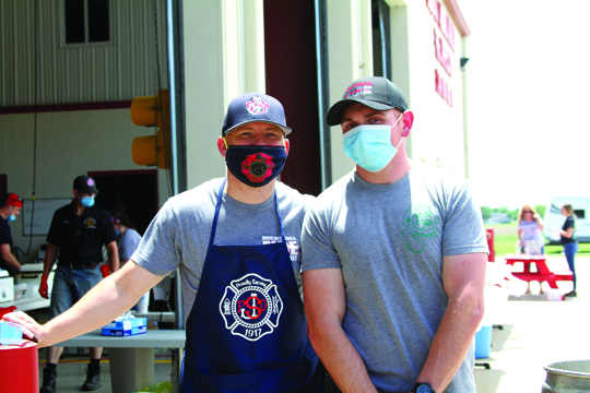 Photos by Marcy P  Firefighters Ryan Deeder and DJ Jewel were part of the group of volunteers that assisted with the annual fundraising event.
