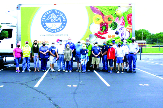 The Jacksonville Kiwanis Club answered the call for help from the Central Illinois Food Bank with nearly thirty members showing up to volunteer on June 10th to help distribute boxes of dairy, vegetables and chicken to 250 households.