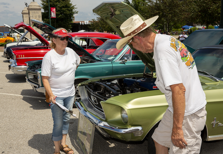 Pam and Woody Logan, of Philadelphia, judge Pam Meyer's 1966 Ford Mustang. This Mustang delivers 27 mpg and features a large torque converter and special gears for efficiency while cruising.