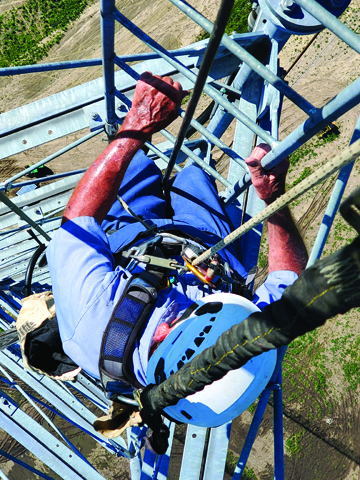 Photos Submitted to The Source Eighty-five year-old Ed Bergschneider recently climbed a tower near Franklin, before purchasing the scrap metal.