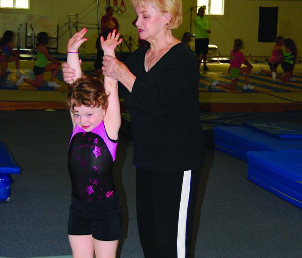 Eleanor Stevens instructs Kolby Hoffman.