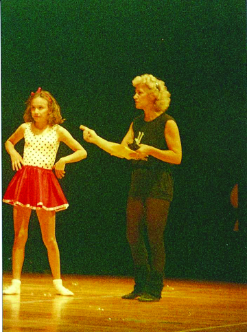 Donning legwarmers, popular of past times, Eleanor Stevens instructs a student.
