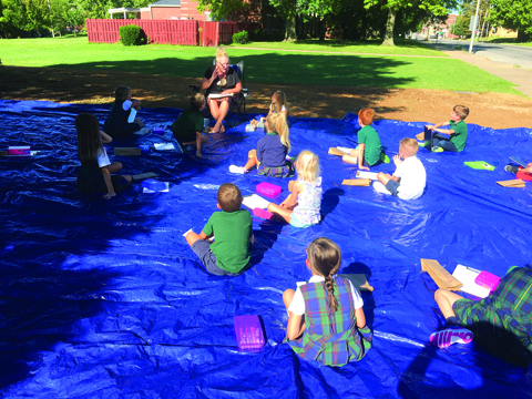 Photo Submitted to The Source Our Saviour School first grade teacher Mrs. Dietrich and her students take advantage of their outdoor learning space during the first week of school recently in Jacksonville.