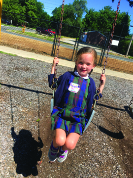 Photo Submitted to The Source Kindergarten student Ceci B. swings and enjoys the sunshine at recess recently at Our Saviour School in Jacksonville.