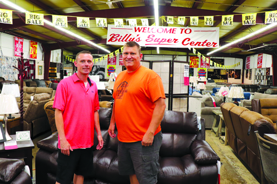 Photos/Lynn Colburn Inside the main room of Billy's Furniture in Jacksonville. Pictured left to right: Kenny Miller, vice president of operations, and owner Billy McCurley.