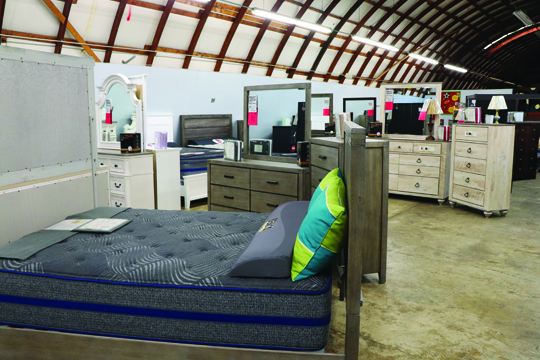 Photos/Lynn Colburn Selection of beds and dressers in the store.