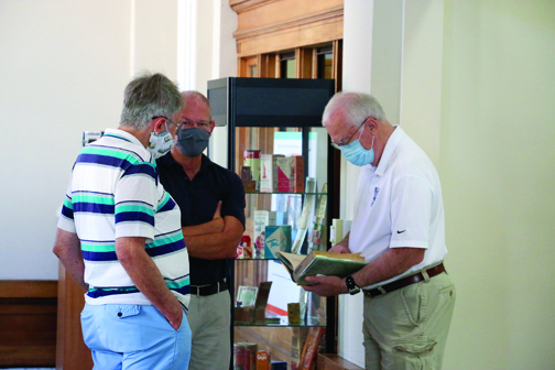 From left, Heritage Cultural Center board member John Clancy, Greg Olson and Forrest Keaton discuss a variety of subjects.
