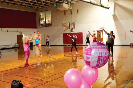 Everyone was reminded of the cause of fighting breast cancer with the pink decorations, pink balloons, ribbons and Christensen's pink attire that she adorned to help paint the dance floor pink!