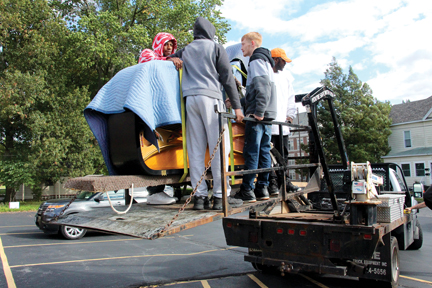 Photos/Jeff Davidsmeyer The Steinway is raised on a lift at one point in the move.