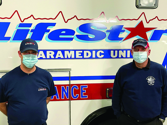 Members of LifeStar Ambulance were part of the first wave of people to receive the COVID-19 vaccine this month. David Salcido and Tim Casey.
