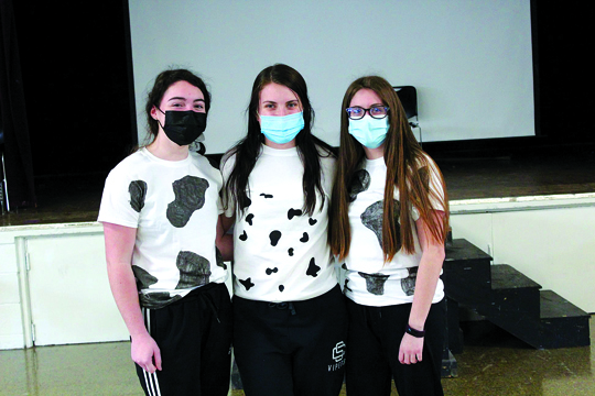 Team Maximilian Kolbe showed up to school as a herd of cows this morning! Pictured here are Emily, Kendall, and Brooke | Community Day