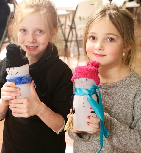Nena, 9, and Cloie, 8, had fun creating decorated water bottles at the event. The sisters came with their mom, Teri Collins, to the festival