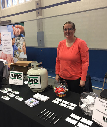 Colleen Doyle of ILMO Products stands behind their table of information about the gas and propane industry.