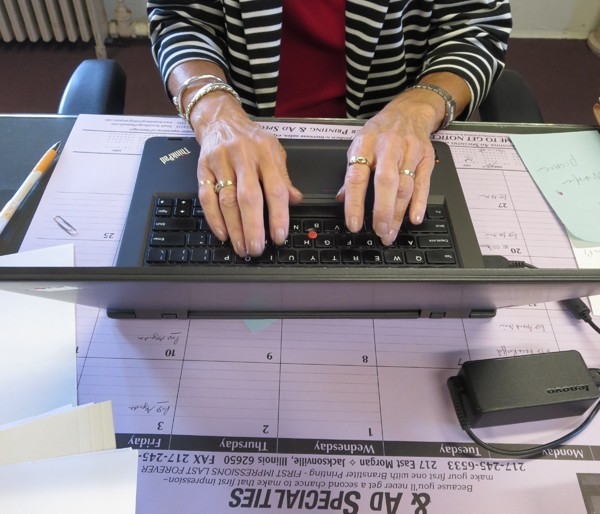 If the Morgan County Commissioners' Office had a soundtrack, it would be the quick tapping of keys, the shuffling of papers and the purr of the copy machine.