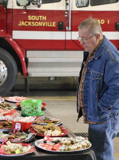 "Photo/Kyla Hurt. When done with his cookie selections and asked if he was going to eat the sweets himself or share them, this shopper said with a sneaky giggle, ""First, I have to hide them."""