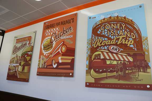 "The new restaurant in themed inside, creating an updated nostalgic feel; ""We are proud to stick to our roots and honor the past, while still growing with the changing times"" states awrestaurants.com. Retro-looking posters are used to add a touch of décor from yesteryear"
