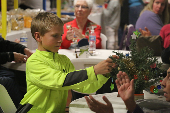 Tyson Nicholson is thoughtful, taking his time to perfect his tree he decorated for family.