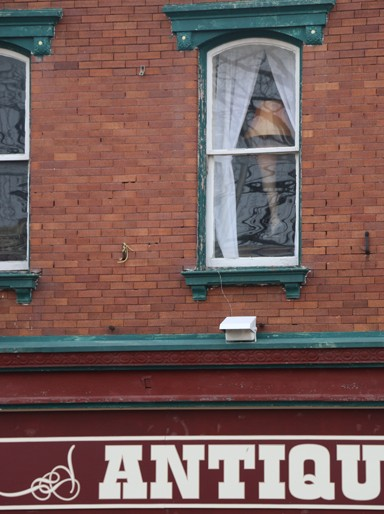 "Photo/Kyla Hurt. The notorious leg lamp, as seen in ""A Christmas Story,"" decorates an upstairs window on the square. The leg is decoration from The Odd Fellows, a group in Winchester who made the music piping downtown during the event possible."
