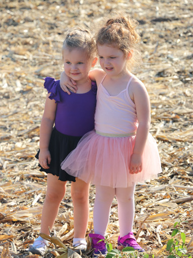 Little ladies in tutus: Alaina and Lily Freeman. Such juxtaposition. Worth a smile.