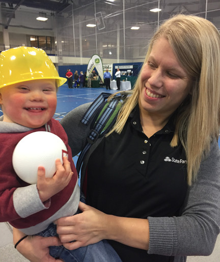 Hylan Degroot, son of Tacy Mayner and Jared Degroot, smiles along with his mom and a few giveaways he gathered at the show.