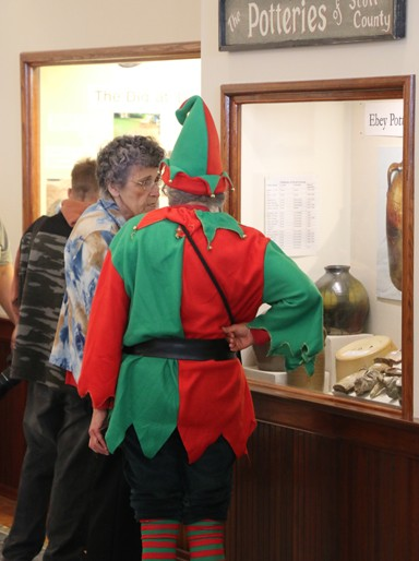 Photo/Kyla Hurt. Docent at the Old School Museum, Janis Dappert, dressed as one of Santa's elves during the event. Dappert guessed there were over 130 people throughout the day; the museum was opened especially for the community's Christmas fun.
