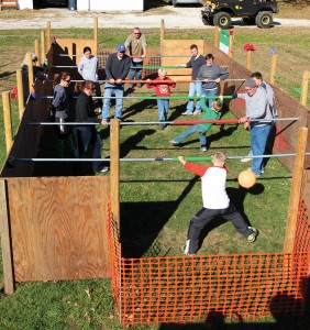 Photos/Kyla Hurt  The adult-sized foosball table made for the Mussatto Annual Family Reunion was the center of attention for the group's yearly get together. Of course, the burgoo and family fun were top priorities, as well. Shown in the images are members of the Mussatto family competing in human foosball during their reunion. Game on!