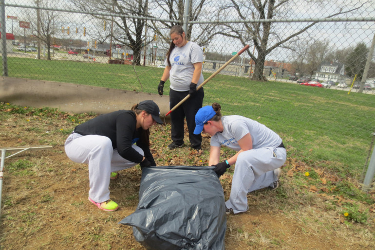 The thirty-five members from the Illinois College Softball team spent two hours at the Jacksonville Area Baseball Fields at Community Park raking leaves, raking the infield and preparing the dugouts for the upcoming softball season.
