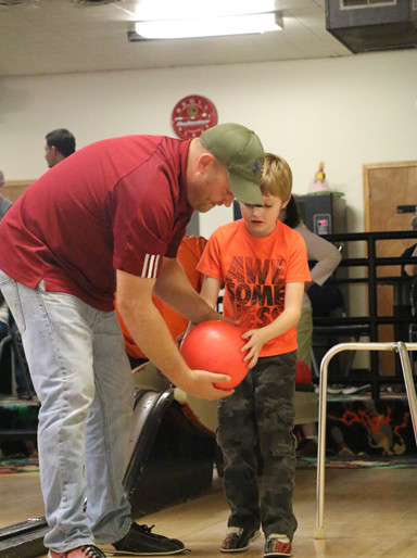 """The kids seemed to take interest in the bowling afternoon, having fun and participating along with their """"pin pals."""" Pin Pals on this particular Sunday included: Camilla Nicoletta, Ethan McDaniel, Rebekah Webster, Cullen Newport and Rebecca Peterson."""