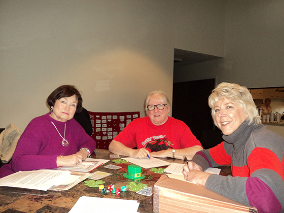 Literacy Committee members Kathy English, Martha Houck, and Debbie Bicknell work on book orders for the year.