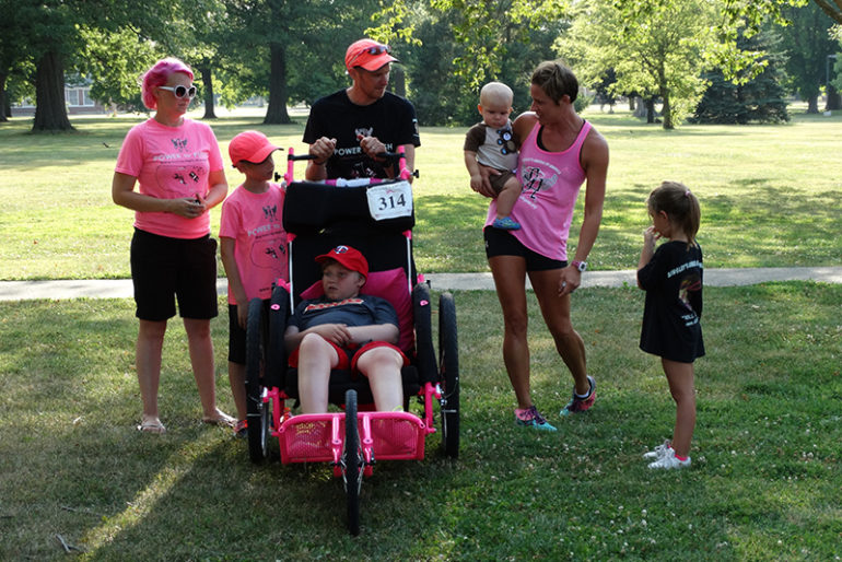 "Rachel Antle, Central Illinois ambassador for Ainsley's Angels, said they had four local members running with the Evans family throughout the 19-mile run into Jacksonville. The local chapter met them in Arenzville and ran with them to Crazy Horse Campgrounds, where the family stayed for the evening.  She explained to the group that, ""this year Simon has decided to run a 5K every five days with his dad and brother."" He ended up running even more that day in Jacksonville."