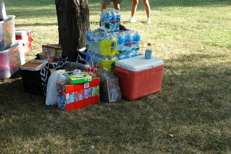 The Evans met with other Ainsley's Angels supporters in Community Park around 6 p.m., had refreshments and presented the Evans family with donated supplies to keep the family going, including bottled water (Shaun, the father, goes through many bottles each day on their trek), snacks, toys and more.