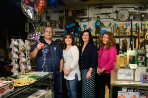 The thirtieth anniversary of the Military Surplus Outlet at 1902 S. Main Street in South Jacksonville did not go unnoticed. Left to right are Tom Holmes, owner, and his daughters, Cathy Hansell, who works with her dad; Dixie Freehill and Diana Tone.